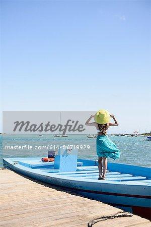 Woman standing on boat in ocean