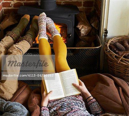 Children relaxing by fire