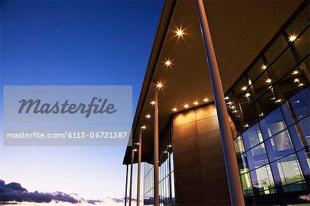 Modern building illuminated at sunset