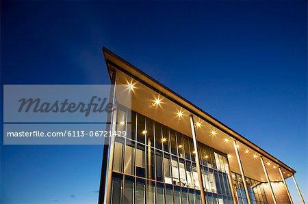 Modern building illuminated at dusk
