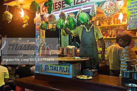 People at a food stall, Juhu Beach, Mumbai, Maharashtra, India