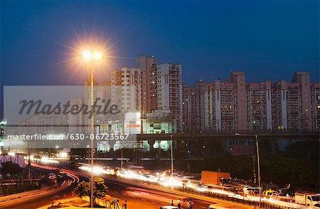 Traffic on the road at night, IFFCO Chowk, Gurgaon, Haryana