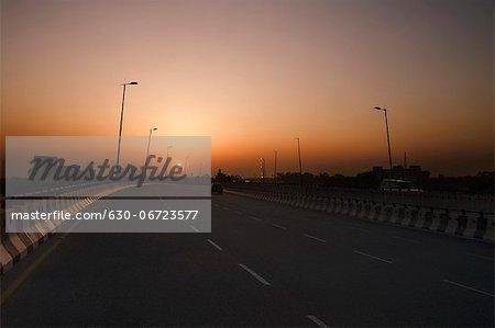 Road at sunset, National Highway 8, Gurgaon, Haryana, India