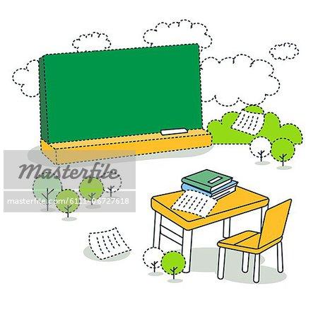 Chair and desk against blackboard