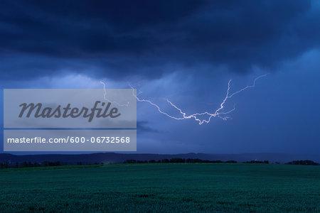 Lightning in Sky over Field. Bavaria, Germany.