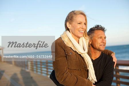 Portrait of Mature Couple Standing on Pier, Jupiter, Palm Beach County, Florida, USA
