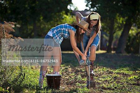 Young Women Gardening, Croatia, Slavonia, Europe