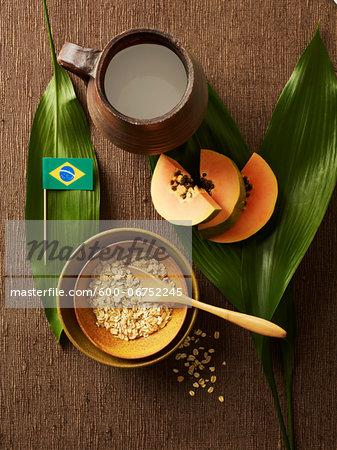 Overhead View of Sliced Papaya, Bowl of Oats, Jug of Milk and Brazilian Flag, Studio Shot
