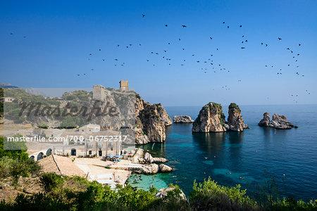 Italy, Sicily, Trapani district, Scopello, Tonnara and faraglioni (stack rocks)