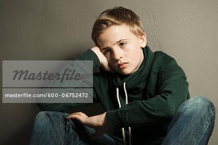 Portrait of Boy Leaning on Hand, Studio Shot