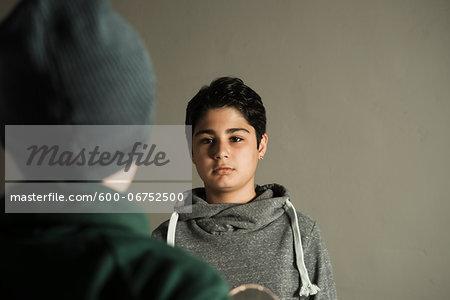 Teenage Boy looking at Boy, Studio Shot