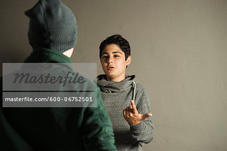 Teenage Boy Talking to another Boy, Studio Shot