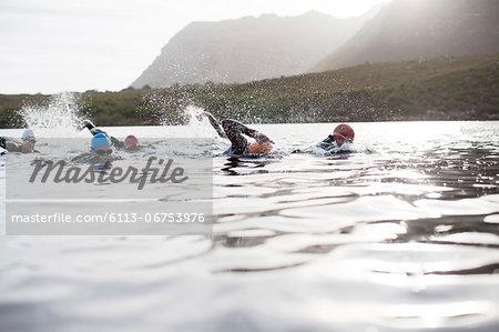 Triathletes swimming