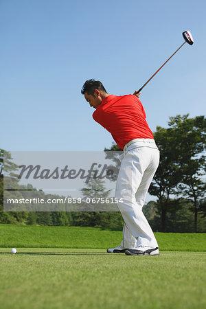 Golfer Concentrating On Shot