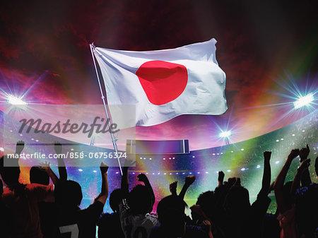Crowd Cheering And Waving Japan Flag In Stadium