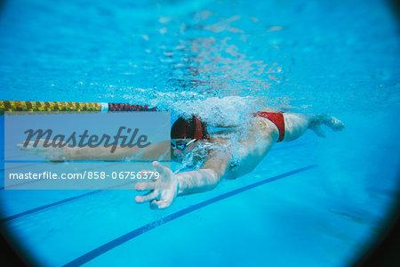 Male Swimmer Underwater In Pool