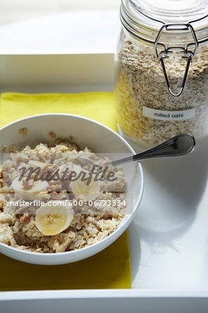 Bowl of Oatmeal with Sliced Banana and Walnuts, Studio Shot
