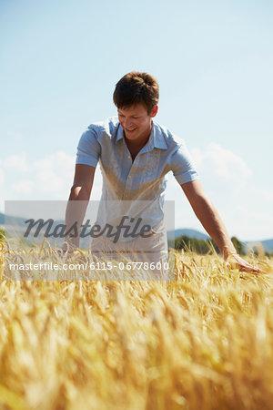Man Standing In Wheat Field, Croatia, Dalmatia, Europe
