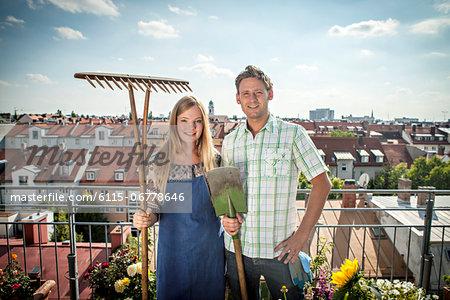 Couple On Balcony, Holding Garden Tools, Munich, Bavaria, Germany, Europe