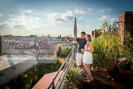 Young Couple On Balcony, Munich, Bavaria, Germany, Europe
