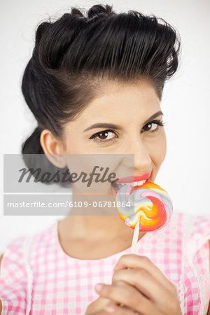 Cute young pinup biting a lollipop