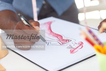 Fashion artistic man drawing clothes