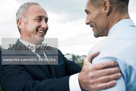 Close-up of businessmen talking
