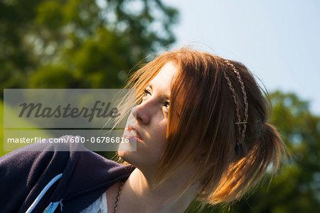 Portrait of teenage girl outdoors, Germany