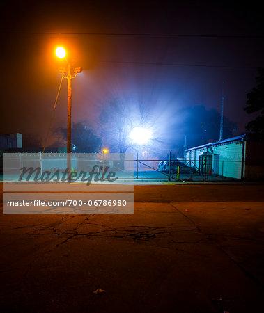 Brightly Lit Fenced Compound at Night, Savannah, Georgia, USA