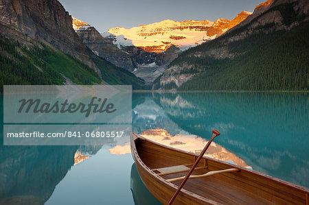 Canoe on Lake Louise at sunrise, Banff National Park, UNESCO World Heritage Site, Alberta, Rocky Mountains, Canada, North America