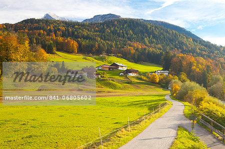 Bicycle path through rural mountain landscape in autumn, near Berchtesgaden, Bavaria, Germany, Europe