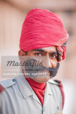 Man in red head dress, Jodhpur, Rajasthan, India, Asia