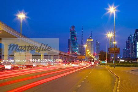 City skyline and car trail lights at sunset, Dubai, United Arab Emirates, Middle East