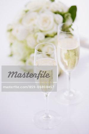 Wedding bouquet and sparkling wine