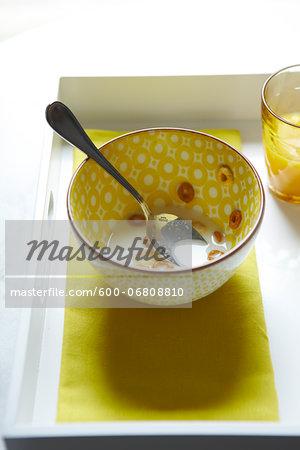 Spoon in Eaten Bowl of Oat Circle Cereal, Studio Shot