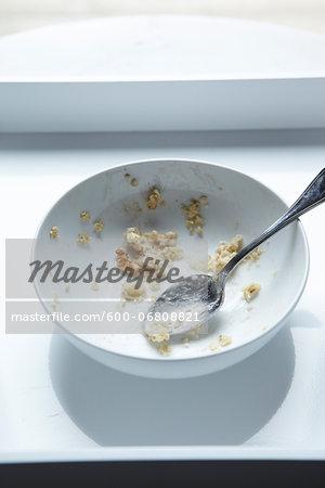 Spoon in Eaten Bowl of Oatmeal, Studio Shot