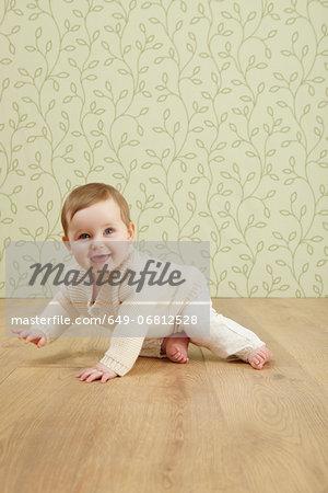 Baby girl crawling on floor