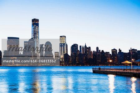 Pier and Manhattan skyline at dusk, New York City, USA