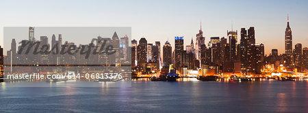 Panoramic view Manhattan skyline and waterfront at dusk, New York City, USA