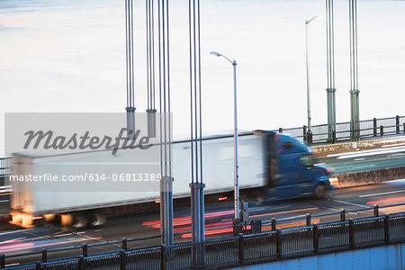 Container truck crossing bridge