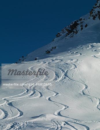 Ski tracks in snow on mountain