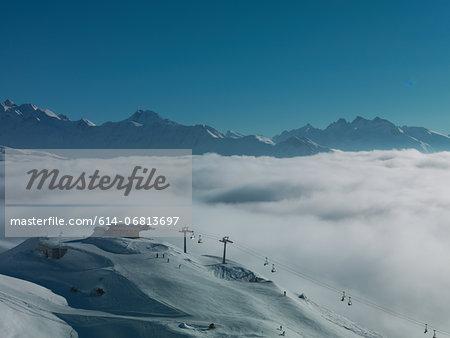 Ski lifts in ski resort with low cloud