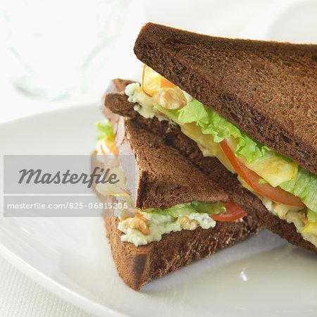 Lettuce,apple and walnut black bread sandwich