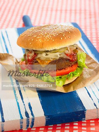 Smoked seitan burger with onions,cheddar,salad and tomatoes