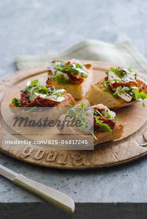 Rocket lettuce,confit tomato and parmesan Bruschetta