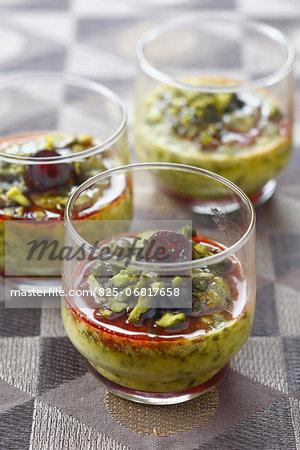 Pistachio cream dessert with stewed cherries