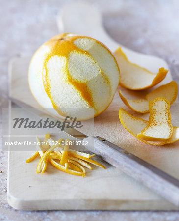 Peeling an orange and making orange zests
