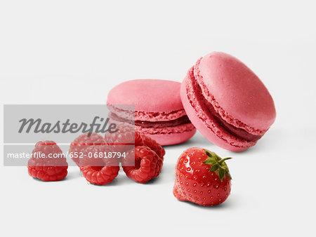 Macaroons and fresh raspberries and strawberry