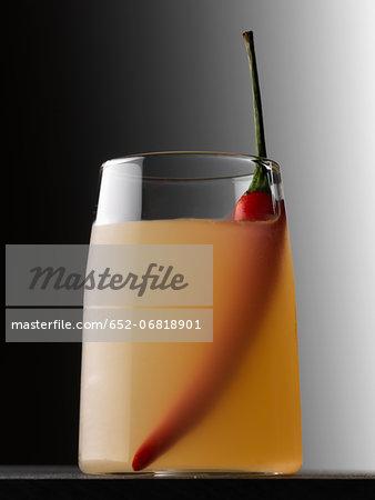 Vodka,orange and red hot pepper cocktail