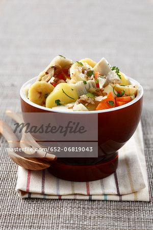 Potato, carrot, artichoke, banana and walnut salad